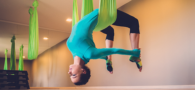Woman performing aerial yoga position