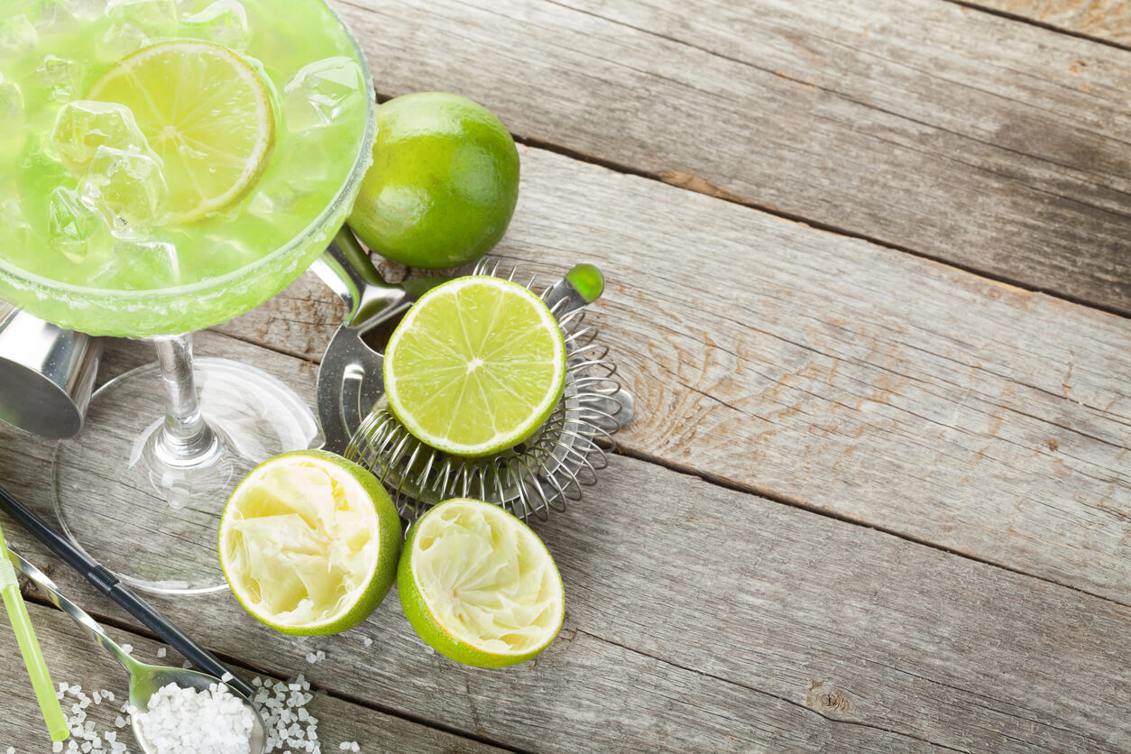 Fresh margarita with limes for National Margarita Day