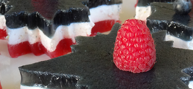 Star-shaped red, white, and blue layered gelatin desserts.