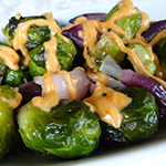 Photo of Roasted Brussels Sprouts and Onions with Sriracha Cream