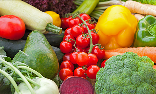 An assortment of summer fruits and vegetables