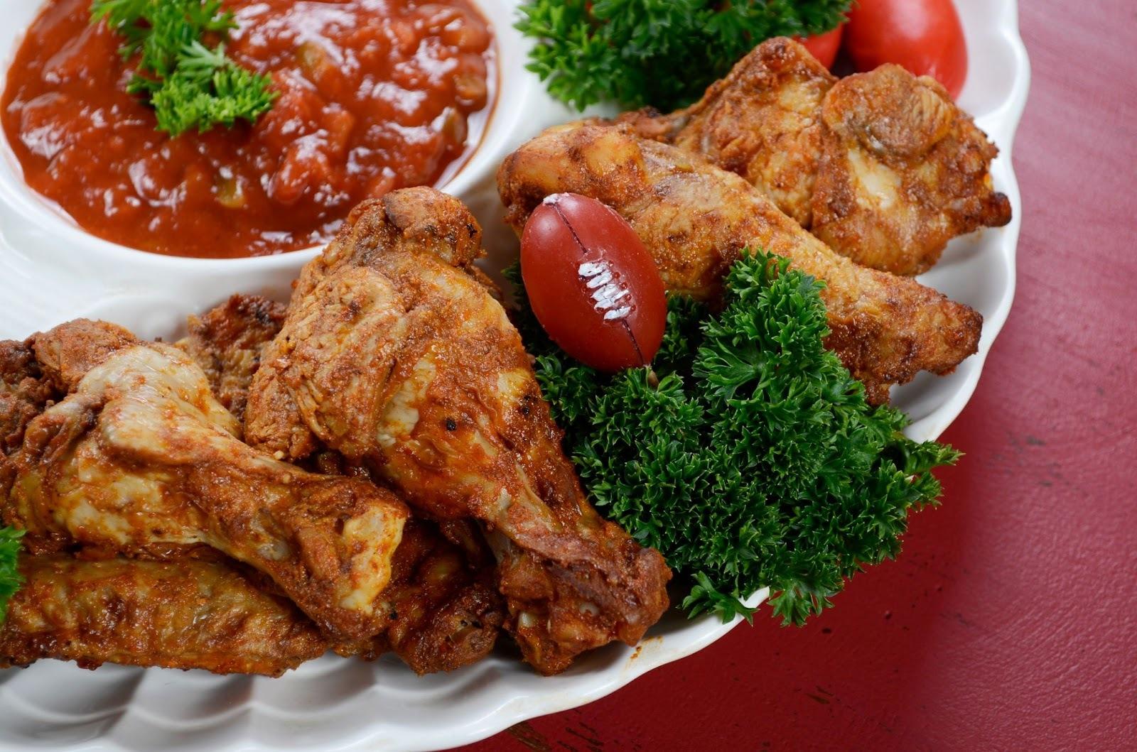 Chicken wings arranged on a platter as keto football snacks.