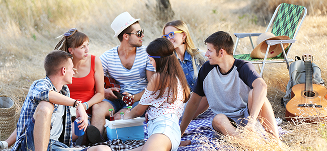 Young adults enjoying a picnic